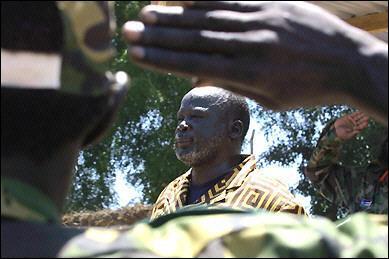 Garang_listen_to_national_anthem_in_Rumbek.jpg