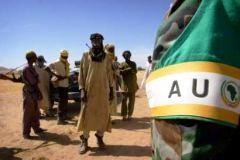 AU_monitor_leaves_a_meeting_with_SLA_rebels.jpg
