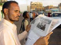 A_Sudanese_man_reads_a_daily.jpg