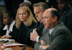 Mia Farrow (2nd L), Chairperson of Dream for Darfur Advisory Board, Ambassador Richard Williamson (2nd R), US Special Envoy to Sudan, listen to US Deputy Ambassador to the United Nations Alejandro Wolf (R) during meeting on June 17, 2008 at UN headquarters in New (AFP)