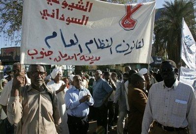 Sudanese opposition supporters hold a banner against the government's electoral laws in Khartoum. (AFP)