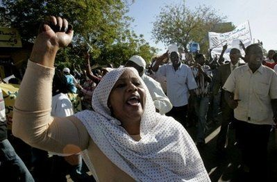 A Sudanese opposition supporter shouts slogans during a protest against the government in Khartoum on December 7. (AFP)