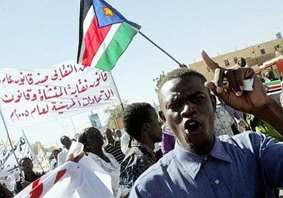 A Sudanese opposition supporter shouts slogans as protesters wave the flag of Sudan People's Liberation Movement (SPLM) during a demonstration against the government in Khartoum. (AFP)