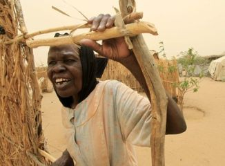 A woman stands near a makeshift tent at Sakale Wali IDPs camp in the South Darfur town of Nyala May 29, 2010. (Reuters)