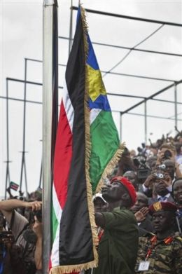 A SPLA Soldier raises the South Sudan flag at the independence ceremony of South Sudan in Juba, South Sudan, on Saturday July 9, 2011. (AP)