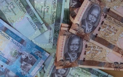 A picture shows freshly-minted notes of the new South Sudan pound, which pictures the late South Sudanese independence leader John Garang, in Juba on July 18, 2011.(Getty)