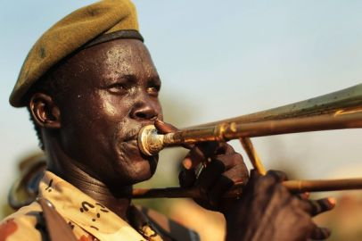 A member of a branch of the SPLA plays a trombone in a pro independence march January 5, 2011 in Juba, Sudan (Getty)