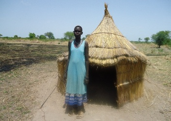 A woman in Adiem village, Warrap state stand in front of her  pit latrine (©UNICEF 2012)