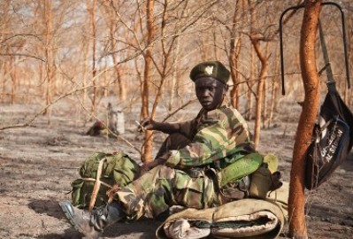 A picture taken on April 15, 2012 shows a soldier of the South-Sudan's SPLA waiting amongst acacia trees at the front lines just north of Heglig (Getty)