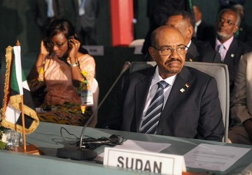 Sudan's President Omer al-Bashir takes part in the African Union Summit on health focusing on HIV/AIDS, TB and malaria in Abuja on July 15, 2013 (PIUS UTOMI EKPEI/AFP/Getty Images)