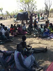Internally displaced persons sit under trees in Melijo, 19km south of Nimule on Friday February 14, 2014 (ST)