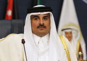 Emir of Qatar Sheikh Tamim bin Hamad al-Thani attends the 25th Arab Summit in Kuwait City, March 25, 2014 (REUTERS/Hamad I Mohammed)