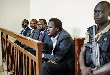 South Sudan political detainees (left to right) Ezekiel Lol Gatkuoth, Majak d'Agoot, Pagan Amum and Oyai Deng Ajak at a trial hearing in Juba on 11 March 2014 (Photo: AFP/Andrei Pungovschi)