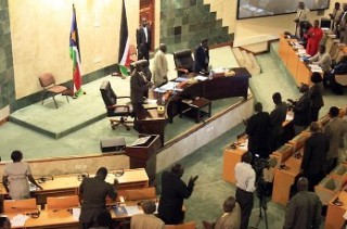 South Sudanese MPs stand during a parliamentary session in Juba on 31 August 2011 (AFP)