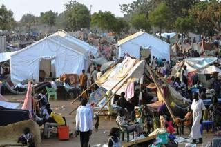 People gather at a makeshift camp for displaced people at a UN compound in South Sudan's capital, Juba, on 22 December 2013 amid fears for further violence (Photo: AFP/Tony Karumba)