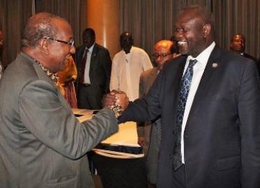 South Sudanese rebel leader, Riek Machar, greets Alpha Konare, former president of Mali and newly appointed  AU  High-level Representative for South Sudan, Nairobi, June 27, 2015 (ST photo)