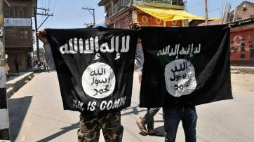 FILE - Two ISIS supporters hold flag (ABC News)