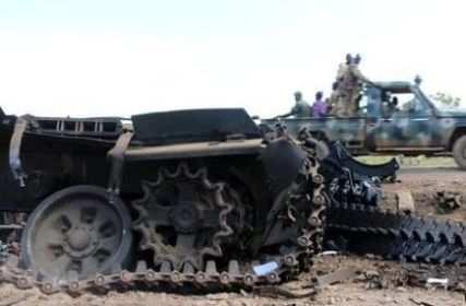 SPLA soldiers drive past military tanks that were destroyed and abandoned in the recent fighting in the Jabel area of Juba, on July 16, 2016 (Reuters Photo)