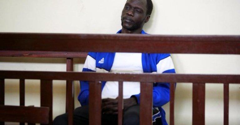 James Gatdet Dak sits inside the dock in the High Court in Juba, South Sudan February 12, 2018. (Photo Reuters-Samir Bol)