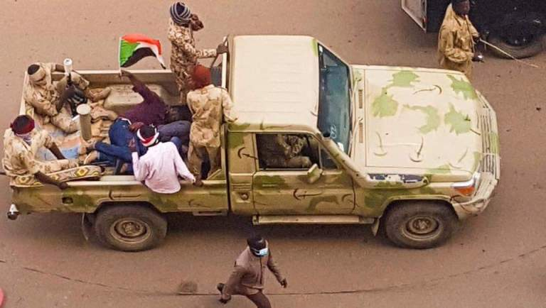 A Sudanese protester continues to raise the national flag after his arrest by security agents in Khartoum on 7 February 2019 (ST Photo)