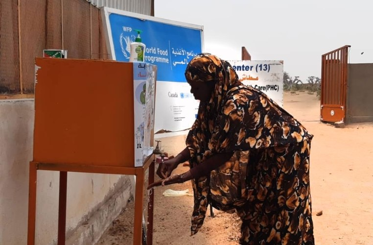 A woman washing hands in Otash camp for IDPs in South Darfur (World Vision photo)
