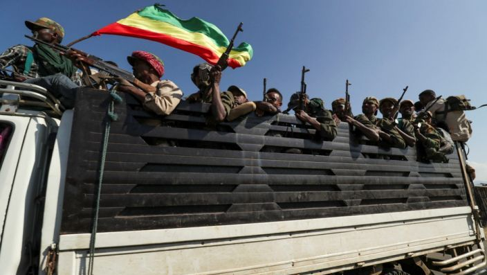 Members of Amhara region militias ride on a truck as they head to face the TPLF, in Sanja, Amhara region near a border with Tigray, on November 9, 2020 - (Reuters photo)